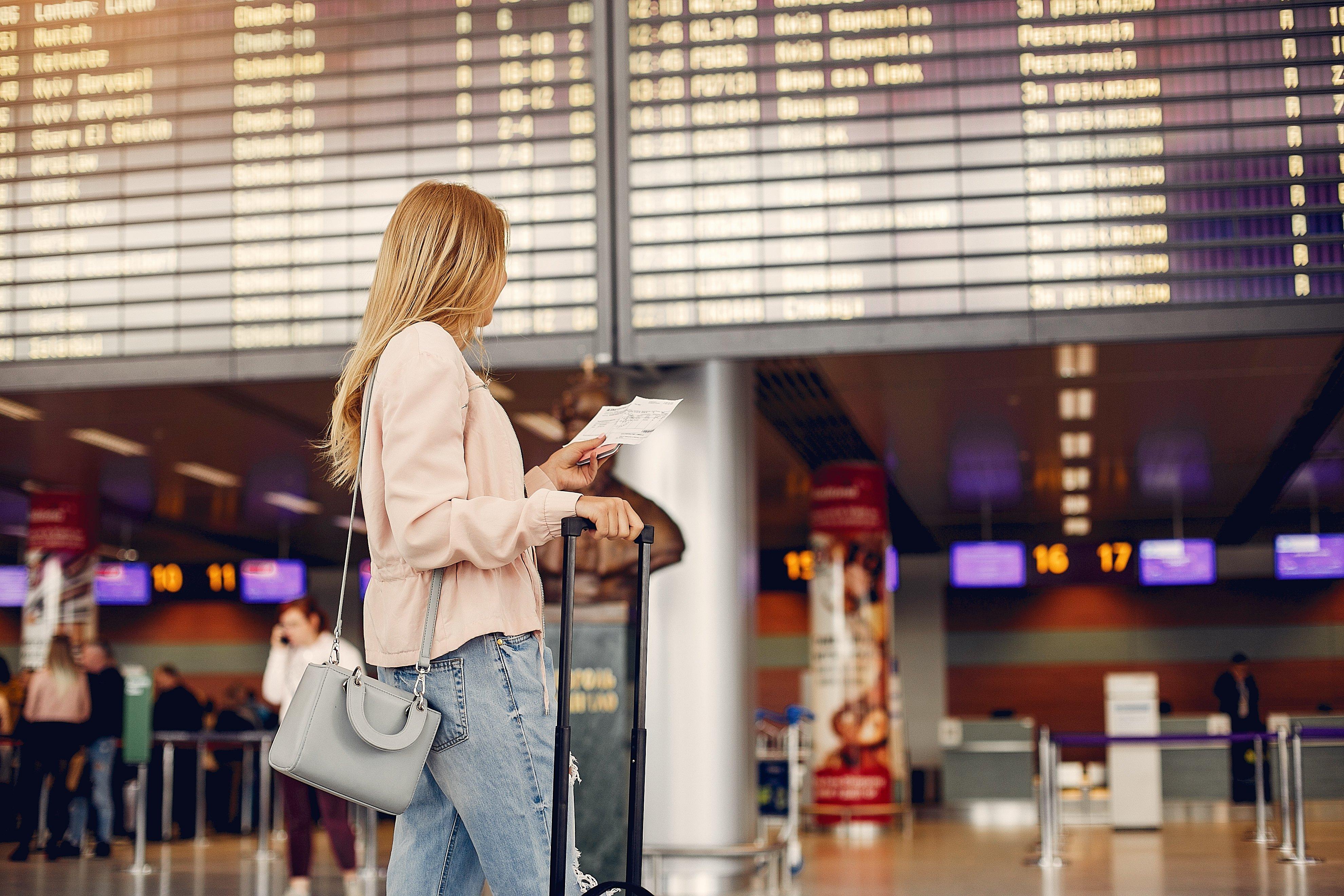 beautiful-girl-standing-in-airport