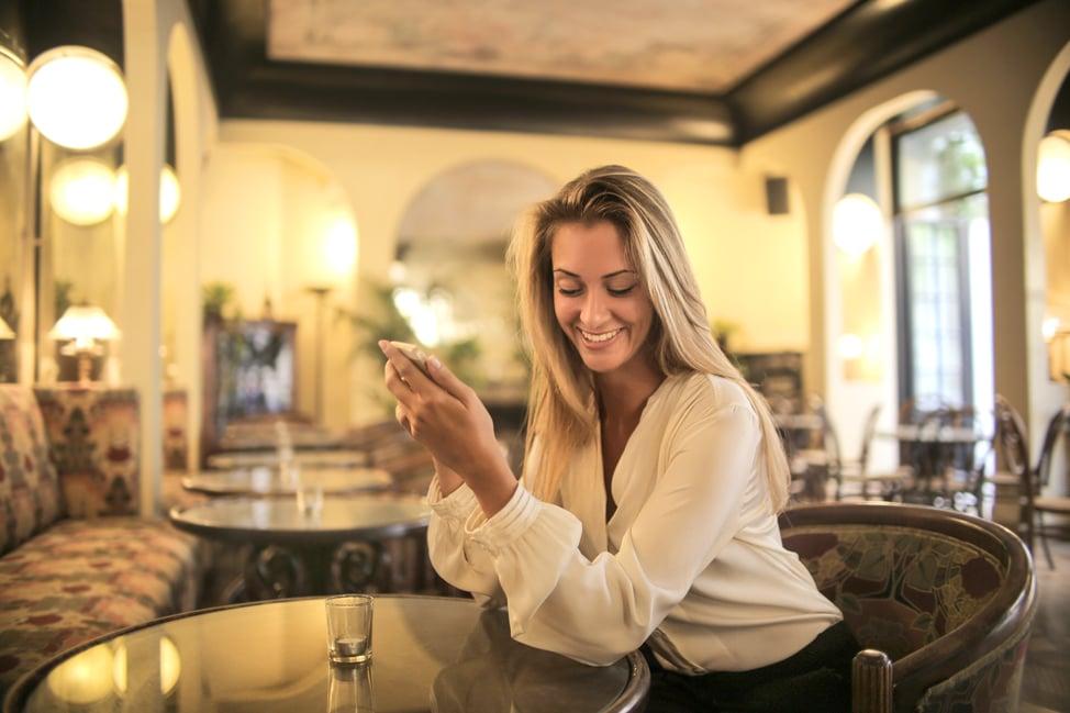 cheerful-female-having-drink-in-elegant-bar-3771833 (1)