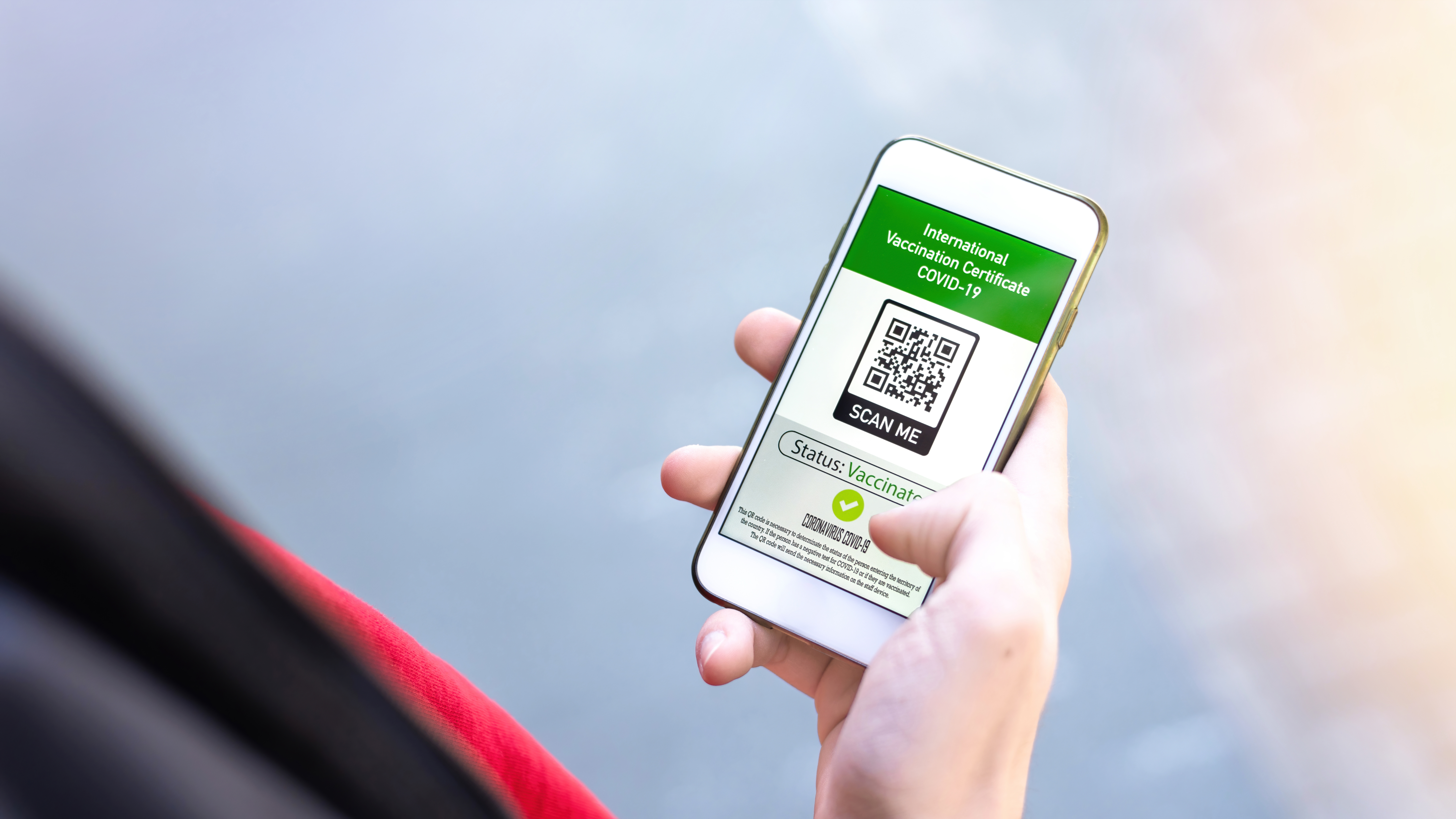 male-hand-holding-smartphone-with-international-vaccination-certificate-covid19-qr-code